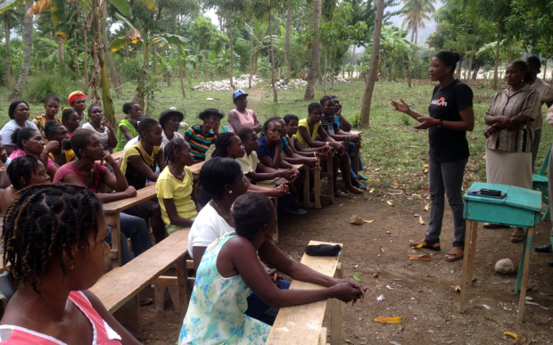 buildOn team members talk to local women as part of their female leadership development initative