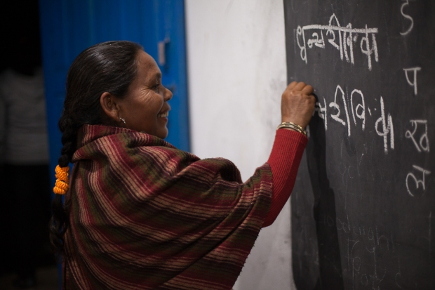 A woman attends a buildOn Adult Literacy class in Nepal
